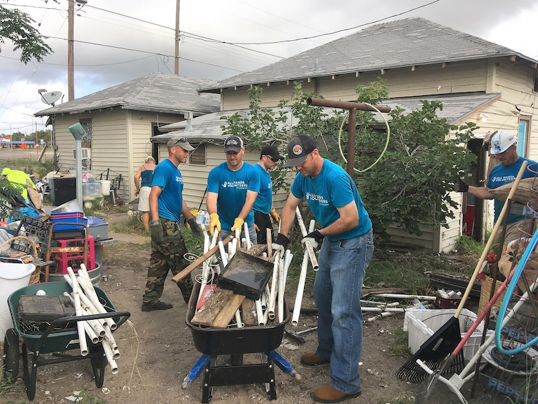 "A handful of Airmen from the 96th Flying Training Squadron, Laughlin Air Force Base, Texas, help clean up damage to a home caused by Hurrican Harvey in August 2017. ""Boxing Bunny"" volunteers  pictured here with the homeowner (back to the camera, far right) include - left to right - Lt. Col. Doug Hayes, Maj. Brian Boettger, Lt. Col. Vinny Danna, 96th FTS Commander Lt. Col. Keith Shearin and Lt. Col. Wolfgang Von Aspe. (U.S. Air Force photo Maj. Jacob Hostetler, jan96th FTS)"