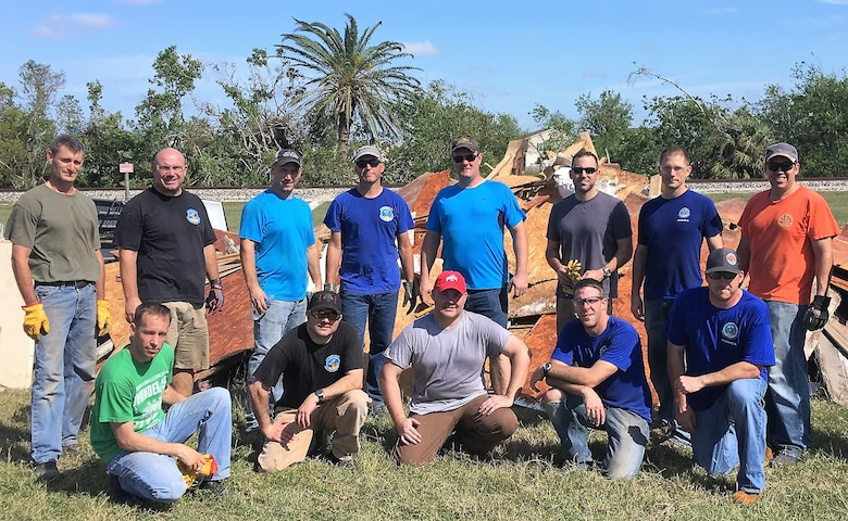 More than a dozen members of the 96th Flying Training Squadron, Laughlin Air Force Base, Texas, used their vacation time to help victims recover from the catastrophic damage incurred during Hurricane Harvey in August 2017. Back row, left to right: Lt. Col. Kervin Waterman, Lt. Col. Wolfgang Von Aspe, Maj. Brian Boettger, Lt. Col. Doug Hayes, Maj. Sam Moore, Maj. William Pope, Lt. Col. Matt Behnken and Lt. Col. Chris Perkins. Front row, left to right: Maj. Aric Wagner, Lt. Col. Vinny Danna, Lt. Col. Kent Bolster, Maj. Jake Hostetler and 96th FTS Commander Lt. Col. Keith Shearin. (U.S. Air Force photo by Maj. David Mitchell, 96th FTS)