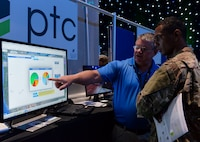 Todd Stecker, exhibitor for PTC, presents his innovative perimeter security ideas to Airman 1st Class Michael Hickson, client system technician assigned to the 353 Special Operations Support Squadron at Kadena Air Base, Japan, at the AFWERX Fusion Experience event in Las Vegas June 20, 2018. Personnel across the Air Force were invited to the event to learn more about instilling a culture of innovation within the military and beyond through a series of presentations, panels and workshops dedicated to perimeter security. (U.S. Air Force photo by Airman Bailee A. Darbasie)