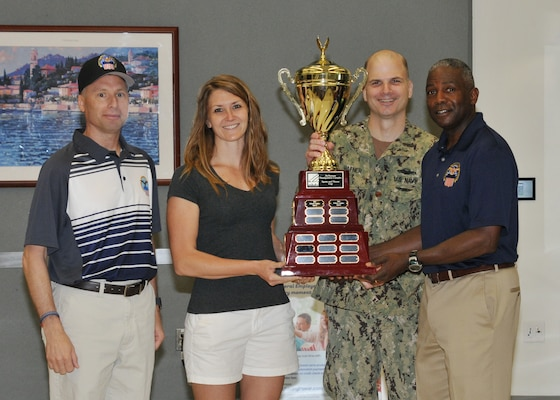 DLA Senior Enlisted Leader and DLA Director present sports and fitness cup.