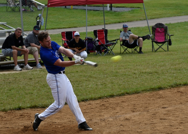 Staff Sgt. Matthew Riggins, National Capital Region Air Force softball team outfielder, connects with the ball during the preliminary round of the Armed Services Classic softball tournament at Jericho Park in Bowie, Md., June 23, 2018. Teams from all five military branches competed for a chance to play in the championship game at Nationals Park in Washington, D.C. (U.S. Air Force photo by Senior Airman Abby L. Richardson)