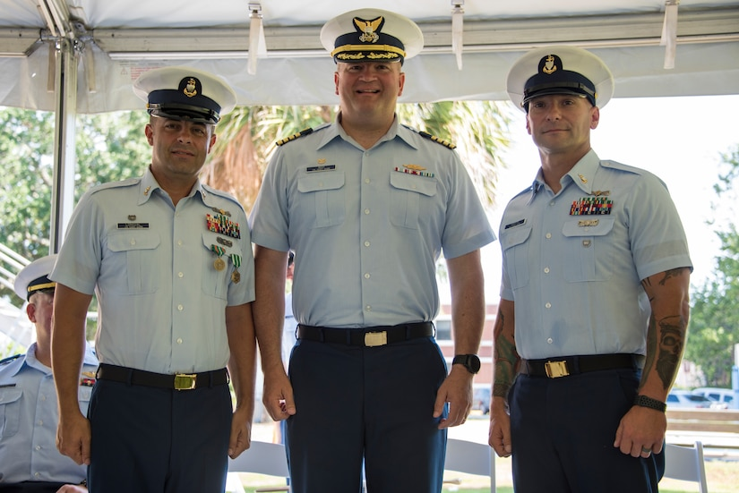 Senior Chief Petty Officer Brian Martin assumes command of Coast Guard Station Charleston from Senior Chief Petty Officer Justin Longval during a change of command ceremony, June 22, 2018, in Charleston, S.C. Capt. John Reed, the commanding officer of Coast Guard Sector Charleston, presided over the ceremony.