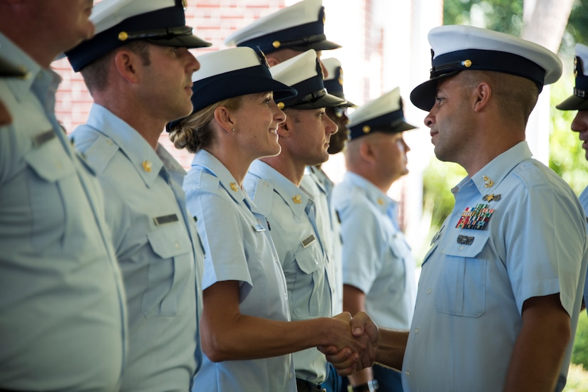 Senior Chief Petty Officer Justin Longval and Senior Chief Petty Officer Brian Martin conduct a personnel inspection during a change of command ceremony, June 22, 2018, in Charleston, S.C.. During the ceremony, Longval transferred command of Station Charleston to Martin.