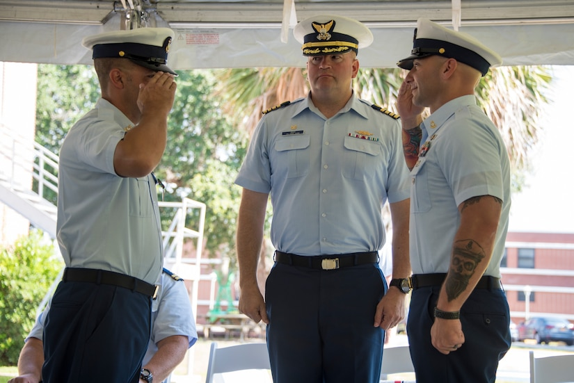 Senior Chief Petty Officer Brian Martin assumes command of Coast Guard Station Charleston from Senior Chief Petty Officer Justin Longval during a change of command ceremony, June 22, 2018, in Charleston, S.C.. Capt. John Reed, the commanding officer of Coast Guard Sector Charleston, presided over the ceremony.