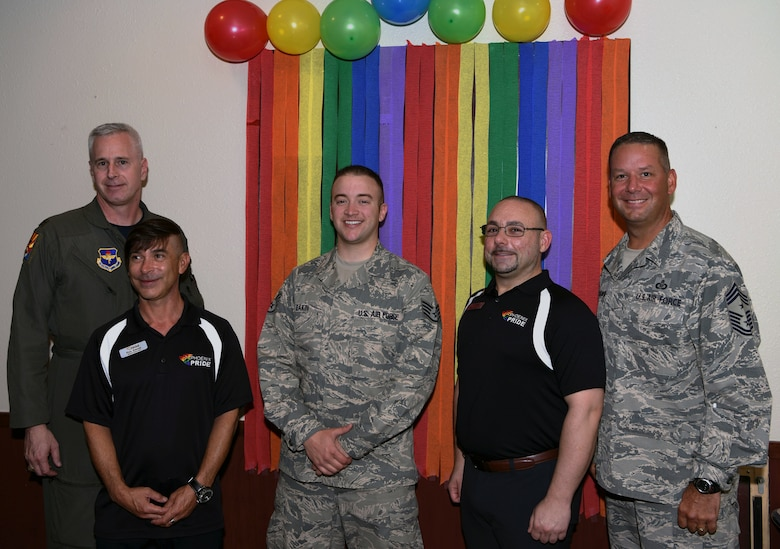 Leadership from Luke Air Force Base and members of Parents and Friends of Lesbians and Gays group pose for a photo after attending the Pride Observation LGBTQ luncheon June 22, 2018. PFLAG is an organization committed to supporting people who are LGBTQ, educating people about the unique issues and challenges facing people who are LGBTQ and advancing equality throughout communities. (U.S. Air Force Photo by Airman 1st Class Zoie Rider)