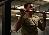 U.S. Air Force Airman Basic Cole Kramn, a Survival, Evasion, Resistance and Escape Specialist Training Orientation Course candidate, conducts a pull-up during a mock physical fitness assessment at the SERE specialist schoolhouse at Joint Base San Antonio-Lackland, Texas, March 22, 2018. Kramn, a Spokane, Washington, native, is one of about 400 candidates to come through the orientation course annually. (U.S. Air Force photo by Staff Sgt. Chip Pons)