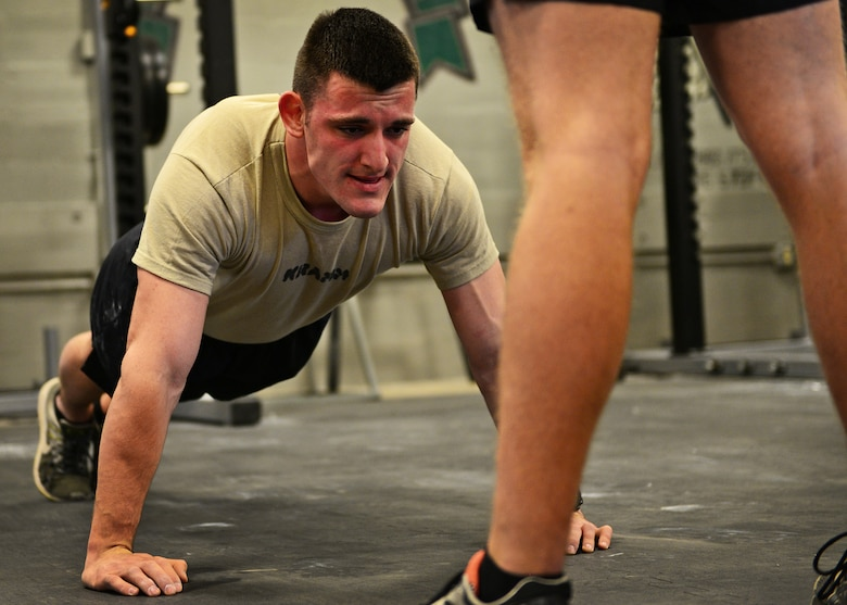 U.S. Air Force Airman Basic Cole Kramn, a Survival, Evasion, Resistance and Escape Specialist Training Orientation Course candidate, completes a push-up during a mock physical fitness assessment at the SERE specialist schoolhouse at Joint Base San Antonio-Lackland, Texas, March 22, 2018. About 60 percent of the SERE specialist candidates do not successfully complete the course, with the majority of candidates self-eliminating from the program.  (U.S. Air Force photo by Staff Sgt. Chip Pons)