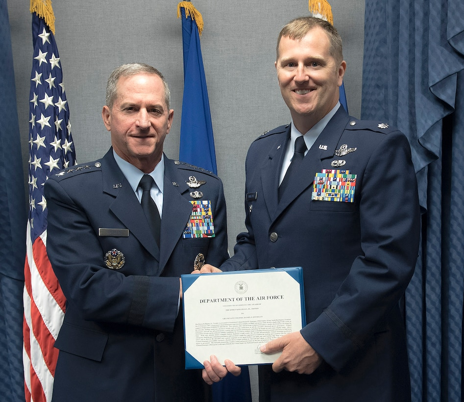 Lt. Col Daniel Finnegan receives the Koren Kolligian Trophy certificate from Air Force Chief of Staff Gen. David L. Goldfein in the Pentagon, Arlington, Va., June 25, 2018. (U.S. Air Force photo by Wayne A. Clark)