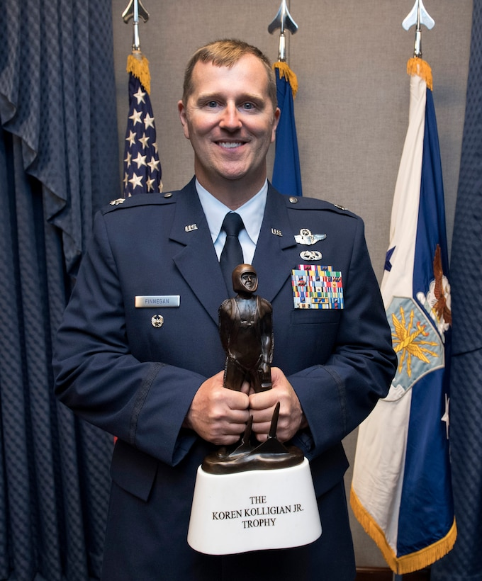 Lt. Col Daniel Finnegan holds the Koren Kolligian Trophy during a ceremony in the Pentagon, Arlington, Va., June 25, 2018. (U.S. Air Force photo by Wayne A. Clark)