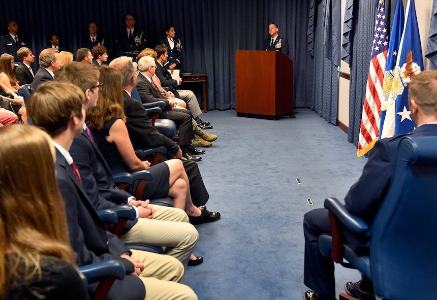 Air Force Chief of Staff Gen. David L. Goldfein talks about the actions taken by Lt. Col Daniel Finnegan during the Kolligian Trophy presentation in the Pentagon, Arlington, Va., June 25, 2018. (U.S. Air Force photo by Wayne A. Clark)