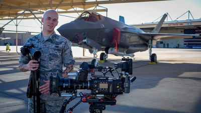 Airman prepares cameras for production shoot.