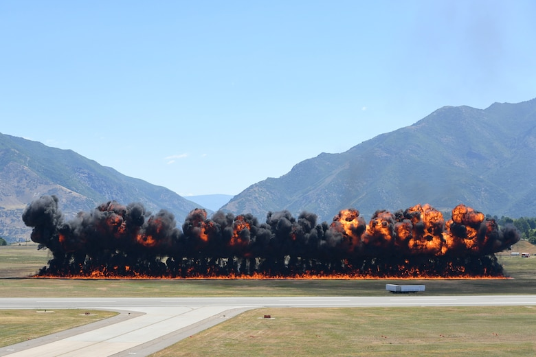 """A """"Wall of Fire"""" explodes during the Warriors Over the Wasatch Air and Space Show June 23, 2018, at Hill Air Force Base, Utah. The explosion was set up and detonated by Firewalkers International Pyro and was the finale to the F-35A attack demonstration at the Hill Air Show June 23-24. (U.S. Air Force photo by Cynthia Griggs)"""