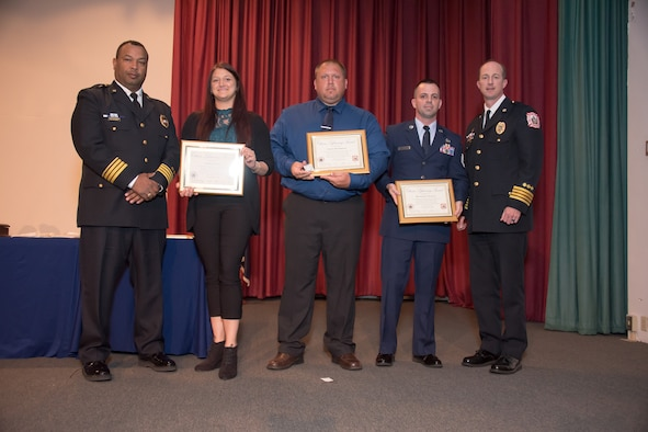U.S. Air Force Tech Sgt. Richard Penny, 633rd Air Base Wing Inspector General management internal control toolset administrator and special access program manager, Adam Bradshaw and Ashley Staley receive Citizen Lifesaving certificates at Fort Monroe, Virginia, June 7, 2018.