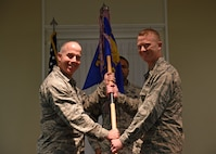U.S. Air Force Col. David Vaclavik, 20th Mission Support Group commander, left, gives the 20th Security Forces Squadron (SFS) guidon to Maj. Scott Haselden, 20th SFS commander, during a change of command ceremony at Shaw Air Force Base, S.C., June 26, 2018