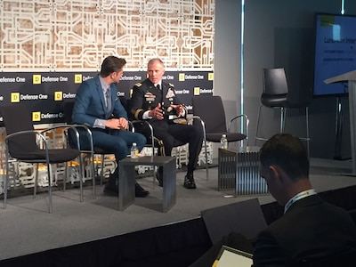 Journalist interviews Army general at technology summit.