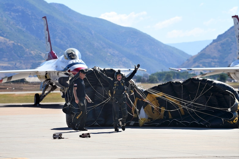 The U.S. Special Operations Command The Para-Commandos parachute demonstration team member lands on the ramp during the Warriors Over the Wasatch Air and Space Show June 24, 2018, at Hill Air Force Base, Utah. The Para-Commandos are comprised of active duty special operators, such as Army Special Forces, Army Rangers, Navy SEALs, Air Force Combat Controllers and Marine Raiders. (U.S. Air Force photo by Todd Cromar)