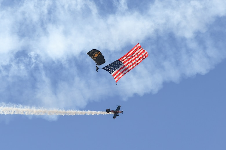 A U.S. Special Operations Command The Para-Commandos parachute demonstration team member performs a National Anthem flag jum during the Warriors Over the Wasatch Air and Space Show June 24, 2018, at Hill Air Force Base, Utah. The Para-Commandos are comprised of active duty special operators, such as Army Special Forces, Army Rangers, Navy SEALs, Air Force Combat Controllers and Marine Raiders. (U.S. Air Force photo by Cynthia Griggs)