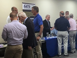 Attendees at Huntsville Center's fourth Resource Efficiency Manager Workshop speak with industry representative during the technology exposition portion of the two-day event.