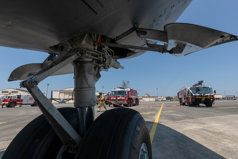 Firefighters with the 374th Civil Engineer Squadron respond to a simulated fire aboard a C-17 Globemaster III during an Emergency Response Exercise
