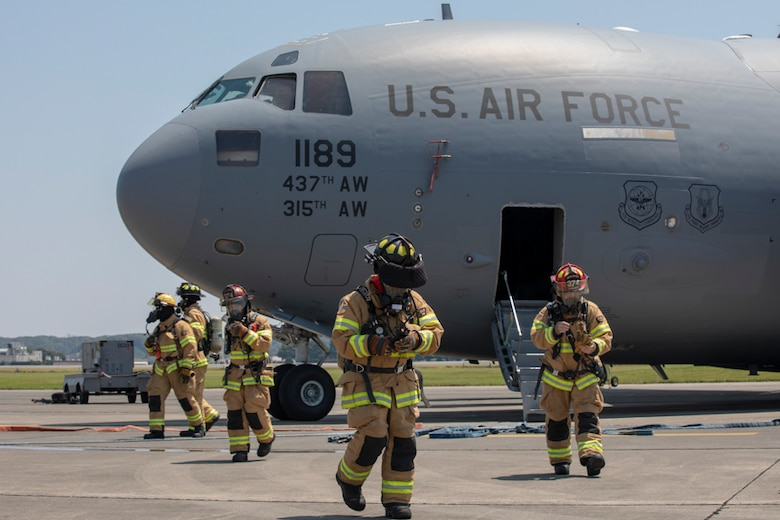 Firefighters with the 374th Civil Engineer Squadron return to the flightline after completing an Emergency Response Exercise