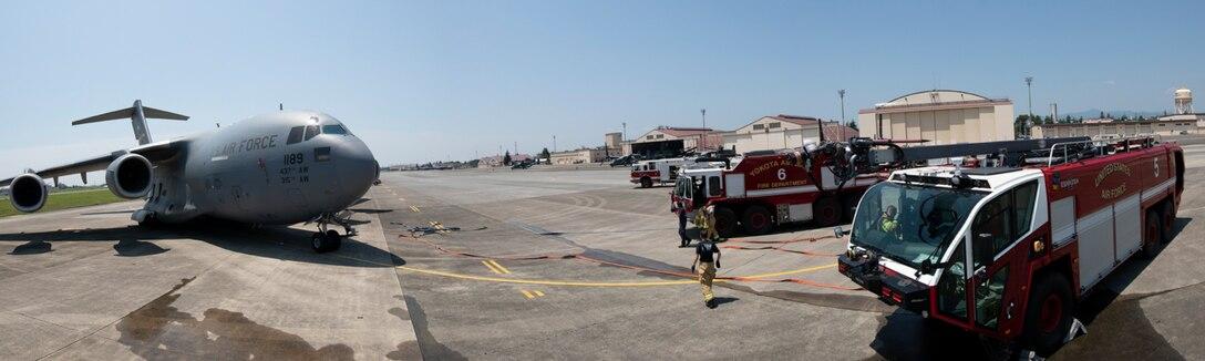 Yokota fire department and 730th Air Mobility Squadron conduct an Emergency Response Exercise at Yokota Air Base, Japan, June 25, 2018.
