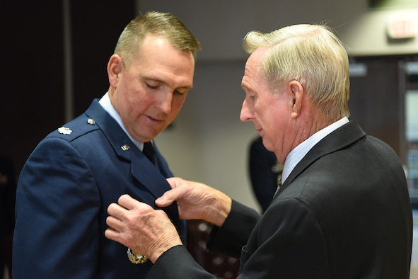CLEAR AIR FORCE STATION, Alaska – Retired Air Force Maj. Don Rutherford pinned the commanders pin on his son Lt. Col. Jeffrey Rutherford during his change of command ceremony, June 13, 2018, at Clear Air Force Station, Alaska. Rutherford succeeds outgoing commander Lt. Col. Joel Lane as 13th Space Warning Squadron commander.