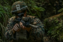 A Marine with Fox Company, Battalion Landing Team, 2nd Battalion, 5th Marines, 31st Marine Expeditionary Unit, conducts practice drills before live fire on a jungle range at Camp Hansen, Okinawa, Japan, June 7, 2018.