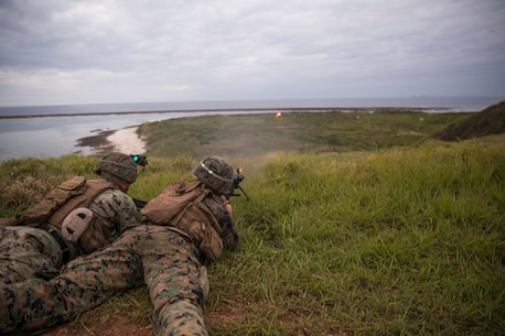 Marines with 5th Air Naval Gunfire Liaison Company fire a M240B medium machine gun loaded with tracer rounds to mark a target during training in Okinawa, Japan, June 4, 2018.
