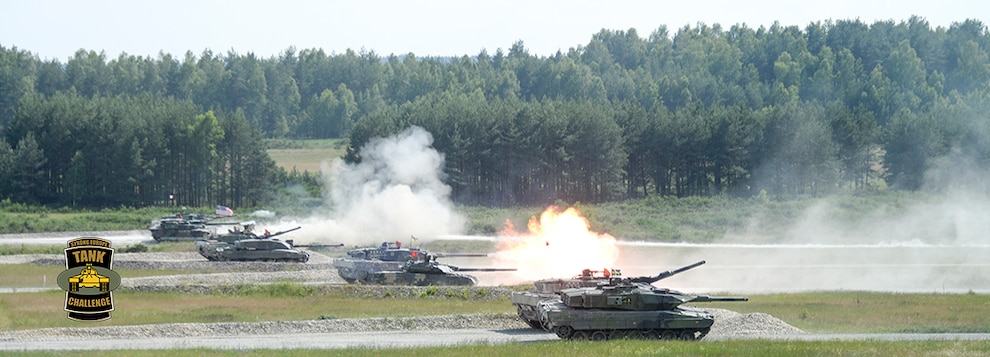 Tanks from Austria, France, Germany, Poland, Sweden, Ukraine, the United Kingdom and the United States fire side-by-side during the Friendship Shoot of the 2018 Strong Europe Tank Challenge, June 8, on the Grafenwoehr Training Area, Germany.
