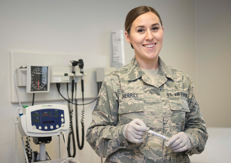 Tech. Sgt. Jennifer Sherrill, an aerospace medical technician, 86th Medical Group, Ramstein Air Base, Germany, poses for a photo in the clinic, June 19, 2018. Sherrill discusses how the guidance of more experienced medical Airmen have improved her capabilities to deliver care downrange. (U.S. Air Force photo by Senior Airman Elizabeth Baker)