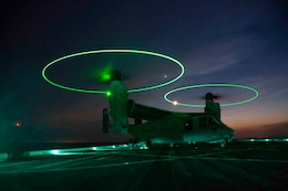 A U.S. Marine MV-22 Osprey with the 22nd Marine Expeditionary Unit lands on the deck of the USS Arlington during Amphibious Squadron MEU Integration training in the Atlantic Ocean, June 15, 2018. PHIBRON-MEU Integration is a two-week training evolution that allows Sailors and U.S. Marines to train as a cohesive unit in preparation for their upcoming deployment.