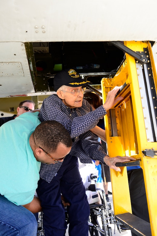 Donald Nesbit, a World War II veteran, is assisted into a B-25 bomber June 22, 2018, at Hill Air Force Base, Utah. The bomber was on display for the Warriors Over the Wasatch Air and Space Show. (U.S. Air Force photo by David Perry)