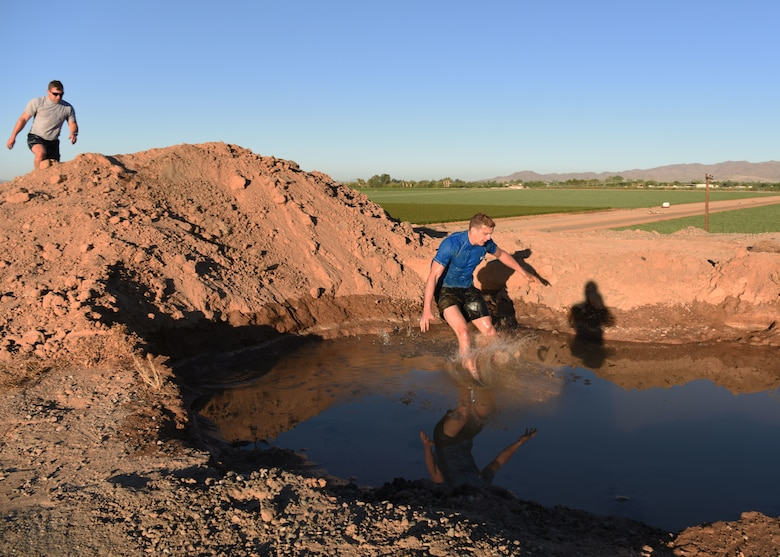 Airmen participate in the 56th Force Support Squadron's 2018 Jump in the Mud 5K June 22, 2018 at Luke Air Force Base, Ariz.