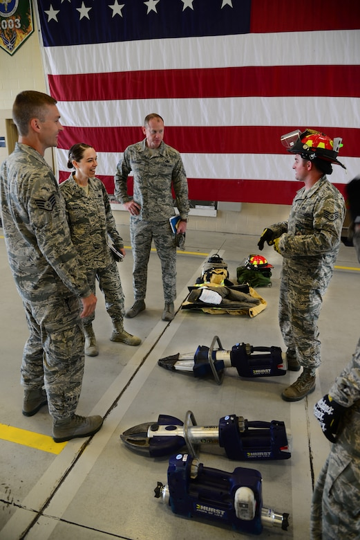 U.S. Air Force Chief Master Sgt. Juliet Gudgel, command chief of Air Education and Training Command, speaks with Staff Sgt. Joshua Kenney, 14th Civil Engineer Squadron station captain, about the various tools used firefighters use to rescue people and protect themselves at Columbus Air Force Base, Mississippi, June 22, 2018. Gudgel toured the 14th CES fire station to see how Airmen work and keep Columbus AFB safe. (U.S. Air Force photo by Airman 1st Class Beaux Hebert)
