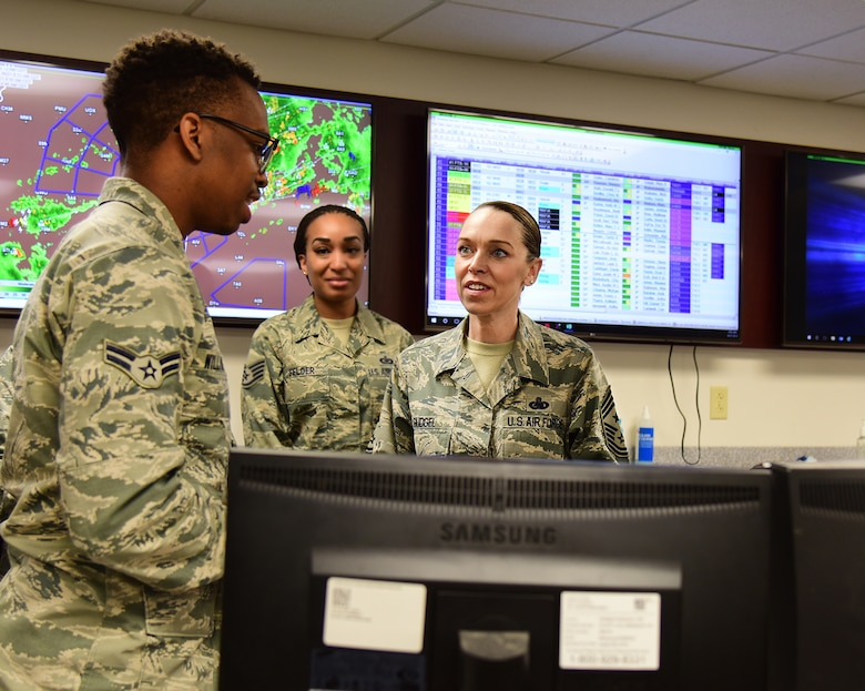 U.S. Air Force Airman 1st Class Rodney Williams, 14th Operations Support Squadron aviation resource manager, talks with Chief Master Sgt. Juliet Gudgel, command chief of Air Education and Training Command, at Columbus Air Force Base, Mississippi, June 21, 2018. Gudgel immersed herself into the 14th Flying Training Wing's mission by visiting various units around base. (U.S. Air Force photo by Elizabeth Owens)