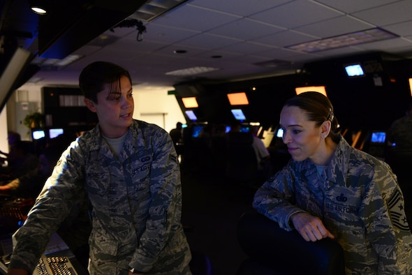 U.S. Air Force Airman 1st Class Jaiden Elmore, 14th Operations Support Squadron air traffic controller, shows Chief Master Sgt. Juliet Gudgel, command chief of Air Education and Training Command, what Airmen in the Radar Approach Control do on a daily basis at Columbus Air Force Base, Mississippi, June 21, 2018. Columbus AFB has the busiest airspace in AETC, flying over 300 sorties per day. (U.S. Air Force photo by Airman 1st Class Beaux Hebert)