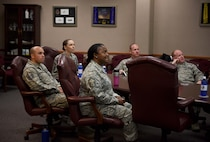 Senior enlisted leaders of the 14th Flying Training Wing and Chief Master Sgt. Juliet Gudgel, command chief of Air Education and Training Command, listen to the history of the pilot training base at Columbus Air Force Base, Mississippi, June 21, 2018. During Gudgel's visit to Columbus AFB, she toured the Air Traffic Control tower and met with one of the 2018 Outstanding Airman of the Year award recipients. (U.S Air Force photo by Airman 1st Class Keith Holcomb)