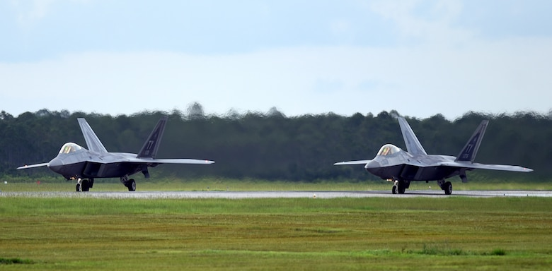 A pair of 95th Fighter Squadron F-22 Raptors prepare for takeoff at Tyndall Air Force Base, Fla., June 14, 2018. The aircraft were launched during a Phase II deployment exercise designed to simulate real-world tactics while testing the ability of maintenance teams and pilots to project unrivaled combat airpower at a moment's notice. (U.S. Air Force photo by Airman 1st Class Isaiah J. Soliz)