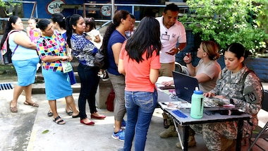 Salvadoran citizens check-in for medical treatment by U.S. military doctors.