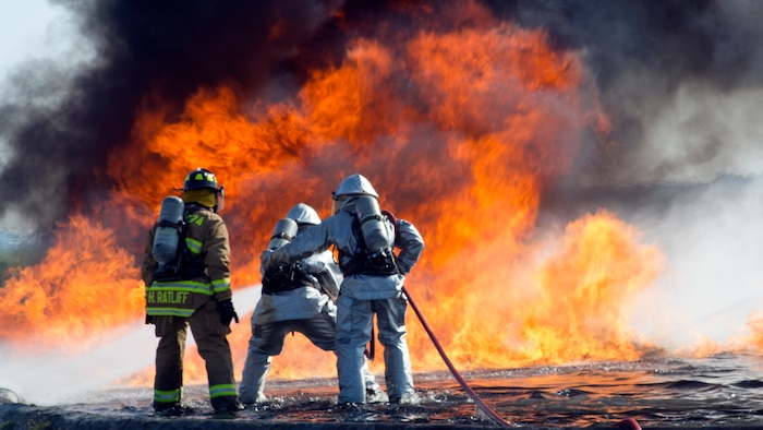 Aircraft, Rescue and Firefighting Marines and Expeditionary Firefighting and Rescue Marines battle a blazing fire during a training exercise at Marine Corps Air Station Cherry Point, N.C., June 21, 2018. The exercise gave Marines firsthand experience fighting the kind of fires they may encounter during their careers. The ARFF Marines are assigned to MCAS Cherry Point and the EFR Marines are assigned to Marine Wing Support Squadron 274, Marine Wing Support Group 27, 2nd Marine Aircraft Wing.