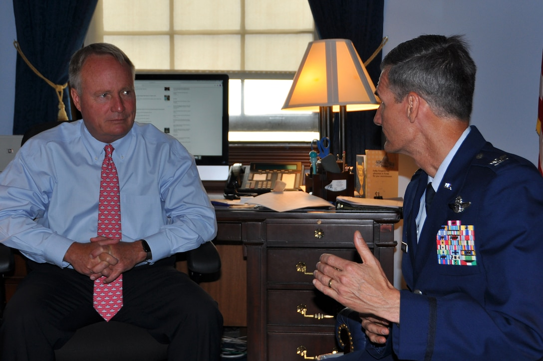 Air Force Reserve 910th Airlift Wing Commander Col. Dan Sarachene (center), based at Youngstown Air Reserve Station, Ohio, talks with Ohio Senator Sherrod Brown, as 910th Airlift Wing Command Chief Master Sgt. Bob Potts listens, during a meeting on Capitol Hill here, June 21, 2018.