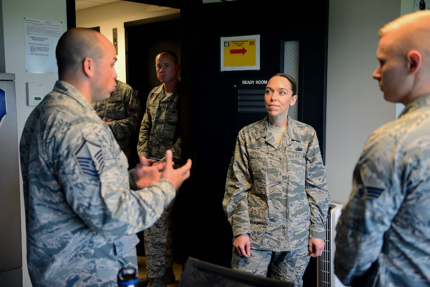 U.S. Air Force Master Sgt. Joshua Matias, 14th Operations Group tower chief air traffic controller speaks with Chief Master Sgt. Juliet Gudgel, command chief of Air Education and Training Command, at Columbus Air Force Base, Mississippi, June 21, 2018. During Gudgel's tour of Columbus AFB, Matias spoke to her about the ATC tower and the operations conducted daily to produce pilots. (U.S Air Force photo by Airman 1st Class Beaux Hebert)