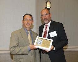 """Jeffrey Stein, an architect with the U.S. Army Corps of Engineers Savannah District received the 2018 """"James Connolly Award"""" during the Society of American Military Engineers Savannah Post's Annual Program Review at the Savannah Riverfront Marriot, June 27.  The Connolly Award is presented each year to a civilian or military engineer within the Savannah community for notable contributions in the field of engineering, particularly in design and construction methods. The award is named in honor of James B. Connolly (1868-1957), who was an Olympic gold medalist, Spanish-American War veteran, distinguished author, and a former Corps' Savannah District employee. Williams is the eighth recipient of the Connolly Award since it was first presented in 2004.  The award was presented by the Savannah Community of Engineer organizations, which includes the Society of American Military Engineers (SAME) Savannah Post and the American Society of Civil Engineers (ASCE) Savannah Branch. Stein was recognized for his outstanding accomplishments in the Corps' Savannah District where he serves as the Chief of Center of Standardization, responsible for planning, directing, coordination, and execution of various standardized Army facility designs that are used worldwide."""