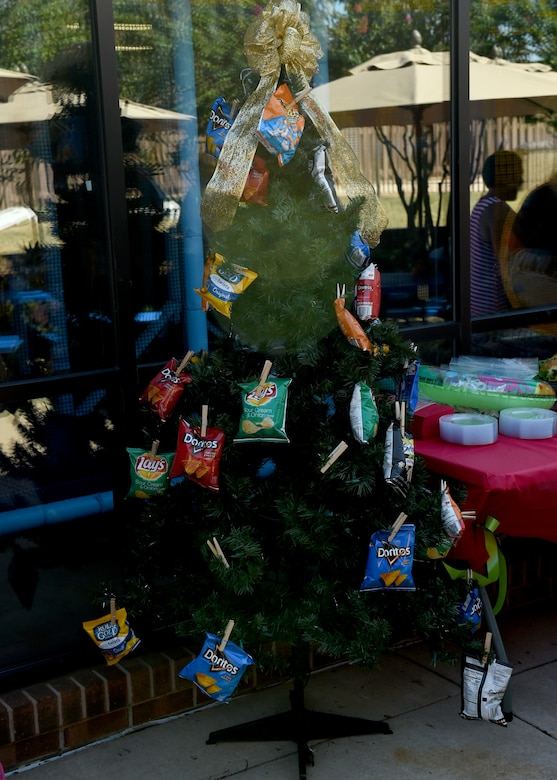 A summer themed Christmas tree stands as decoration for the Hearts Apart Christmas event, June 22, 2018, at Altus Air Force Base, Okla.