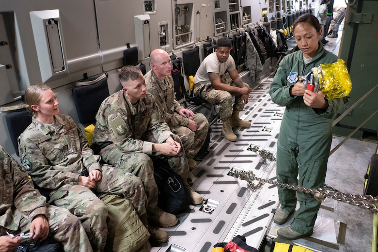 Tech. Sgt. Joleen Morse, 204th Airlift Squadron loadmaster, provides a safety briefing to members of the 435th Contingency Response Squadron on a C-17 Globemaster III in preparation for exercise Swift Response 18