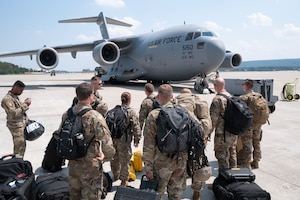 An advance echelon (ADVON) team of Airmen from the 435th Contingency Response Squadron prepare to board a Hawaii Air National Guard operated C-17 Globemaster III in preparation for exercise Swift Response 18 June 5, 2018, at Ramstein Air Base, Germany.