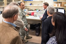 U.S. Air Force Lt. Col. Leonardo Tato, 60th Medical Support Squadron, gives a tour to representatives from NASA during meeting with members of the 60th Medical Group at Travis Air Force Base, Calif., June 1, 2018. NASA and David Grant USAF Medical Center are meeting for a potential collaboration between the two organizations to help in future space exploration. (U.S. Air Force photo by Louis Briscese)