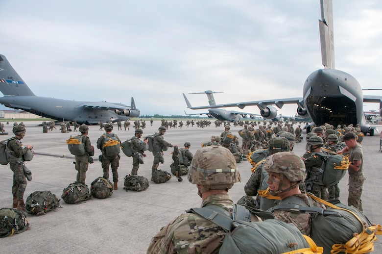 Members of the U.S. Army 1st Battalion, 503rd Infantry Regiment, 173rd Airborne Brigade and Spanish Army Airborne Brigade prepare to board a C-17 Globemaster III during exercise Bayonet Strike June 12, 2018, at Aviano Air Base, Italy.