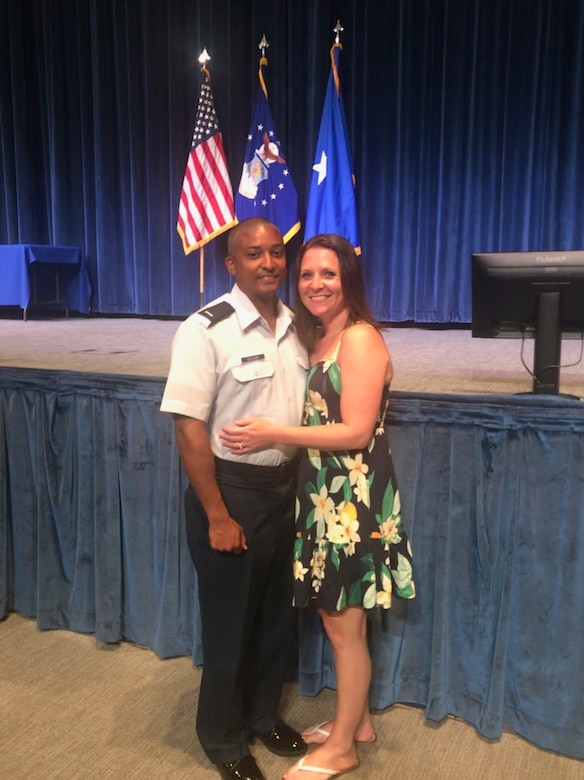 1st Lieutenant Kenneth Ellison poses for a picture with his wife, Melissa Ellison, before the Commissioned Officer Training Class 18-04 Graduation. Ellison commissioned after 14 years of enlisted service and continues his family's legacy of continuous Air Force service since his grandfather enlisted in 1947.
