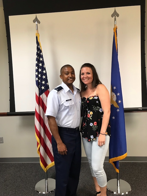 1st Lieutenant Kenneth Ellison poses for a picture with his wife, Melissa Ellison, in the Commissioned Officer Training Class 18-04 classroom. Ellison commissioned after 14 years of enlisted service and continues his family's legacy of continuous Air Force service since his grandfather enlisted in 1947.